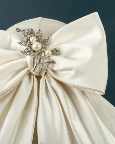 Bow with Pearl Brooch
